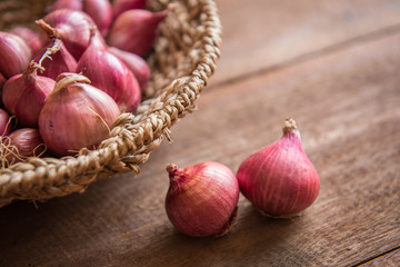 Red onion on a wooden table