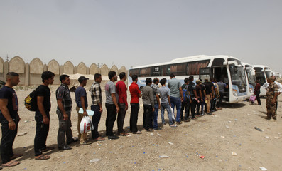 Volunteers, who have joined the Iraqi army, prepare to board a bus in Baghdad
