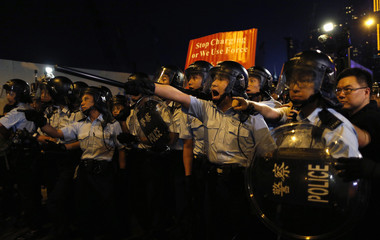 Police shout at pro-democracy protesters during a rally close to the chief executive office in Hong Kong