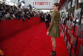 Actress Shailene Woodley poses on arrival at the 2014 MTV Movie Awards in Los Angeles