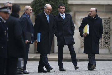 France's Prime Minister Manuel Valls and members of the French government leave the Interior Ministry after the traditional New Year government breakfast in Paris
