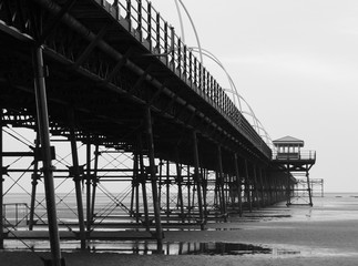 southport pier showing beach and structure in the evening monochrome