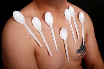 Nermin Halilagic poses with kitchen utensils in Bihac