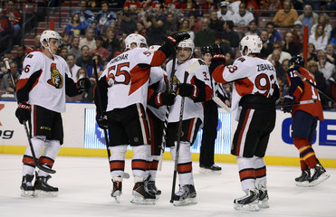 Ottawa Senators' players celebrate their goal against the Florida Panthers during the first period of their NHL hockey game in Sunrise