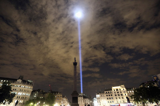 Light is beamed into the sky from Trafalgar Square to mark the100th anniversary of the outbreak of World War One, in London