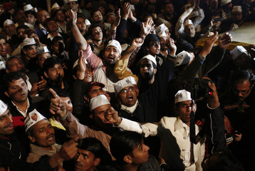 Supporters of Delhi's Chief Minister Kejriwal chief of the AAP shout slogans before he announced his resignation at the party headquarters in New Delhi