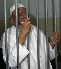 Indonesian militant cleric Bashir speaks to journalists while waiting inside a cell before his trial at a courtroom in south Jakarta