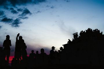 People silhouettes at sunrise in Brazil