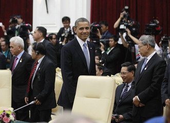 U.S. President Obama walks to his seat as he participates in an ASEAN leaders meeting during the ASEAN Summit at the Peace Palace in Phnom Penh