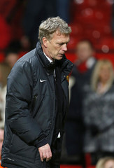Manchester United manager David Moyes walks off the pitch after losing their English FA Cup soccer match against Swansea City at Old Trafford in Manchester