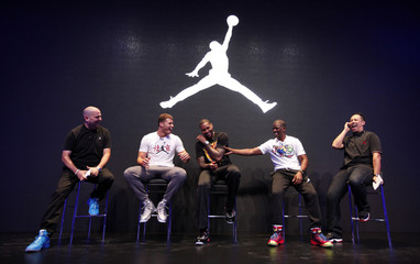 NBA basketball players Anthony of New York Knicks and Paul and Griffin of Los Angeles Clippers speaks to journalists in front of a Jordan Brand logo during a promotional event in Beijing