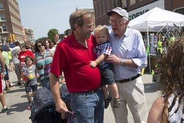 Sen. Bernie Sanders takes a photo with Wade Sick and Emersyn Sick during the Independence Day Parade in Creston, Iowa