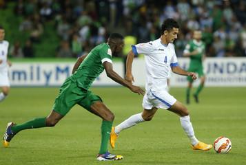Saudi Arabia's Omar Hawsawi (L) challenges Uzbekistan's Sardor Rashidov during their Asian Cup Group B soccer match at the Rectangular stadium in Melbourne