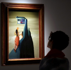 """A visitor views the painting """"Butterflies Lost in the Mountains"""" by Spanish artist Oscar Dominguez at the """"Picasso and the Spanish Modernity"""" exhibition in Sao Paulo"""