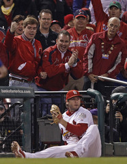 St. Louis Cardinals third baseman Freese reacts after catching a foul ball hit by Texas Rangers' Hamilton during the fifth inning in Game 7 of MLB's World Series baseball championship in St. Louis