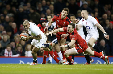 England's Joseph scores a try against Wales during their Six Nations Rugby Union match at the Millennium stadium in Cardiff