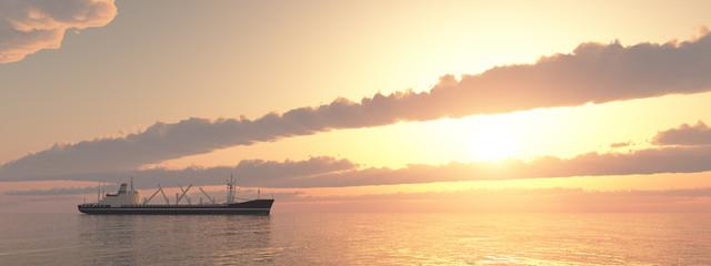 Frachter bei Sonnenuntergang