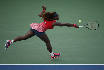 Serena Williams of the U.S. lunges for a ball while playing compatriot Stephens at the U.S. Open tennis championships in New York