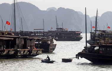 A man sails a boat on Halong Bay, northeast of Hanoi