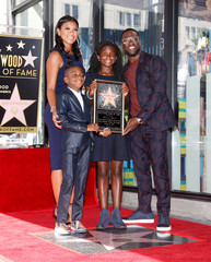 Actor Kevin Hart poses with his family including his wife Eniko Parrish, son Hendrix Hart and daughter Heaven Hart during a ceremony honoring him with a star on the Hollywood Walk of Fame in Hollywood