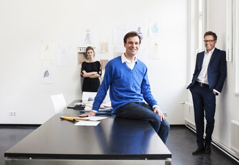 Businessman smiling on desk
