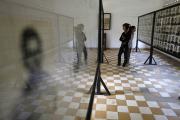 People visit the Tuol Sleng Genocide Museum, also known as the notorious security prison S-21, in Phnom Penh
