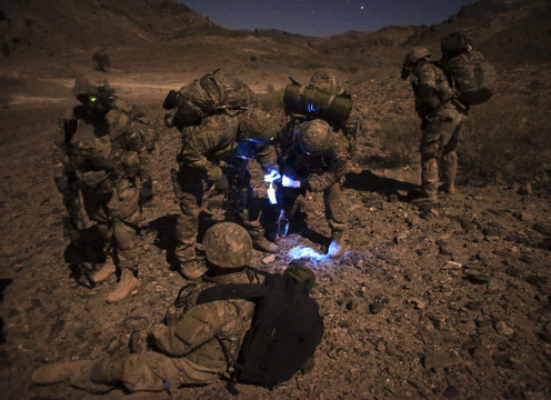 U.S. soldiers look at a map during an operation near the town of Walli Was in Paktika province