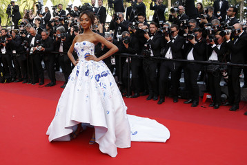 "Model Jourdan Dunn poses on the red carpet as she arrives for the screening of the film ""La fille inconnue"" (The Unknown Girl) in competition at the 69th Cannes Film Festival in Cannes"