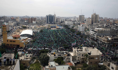 Palestinian Hamas supporters take part in a Hamas rally marking the anniversary of the death of its leaders killed by Israel, in Gaza City