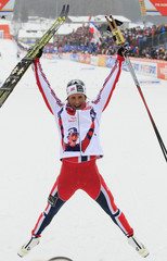 Bjoergen of Norway reacts after winning the women's cross country individual 1.2km sprint classic technique final at the Nordic Ski World Championships in the northern mountain resort of Tesero in Val di Fiemme
