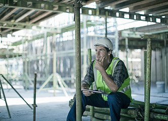 Construction worker using tablet computer