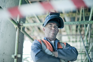 Portrait of construction worker while standing at construction site