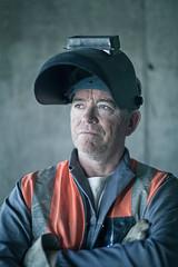 Construction worker in welding helmet