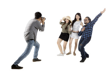 Asian man taking picture his friends on studio