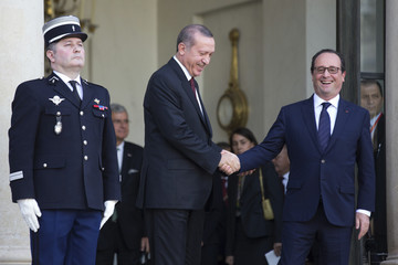 French President Hollande accompanies Turkey's President Erdogan as he leaves the Elysee Palace in Paris