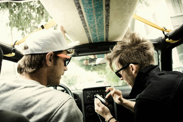 Men listening to mp3 player in car