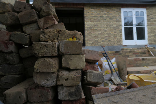 Bricks and tools are seen during construction building work in a residential building in London