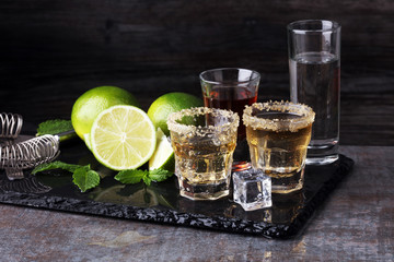 Selection of alcoholic drinks on rustic stone plate