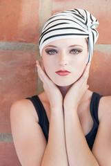 Girl wearing striped turban