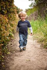 Boy walking on dirt track