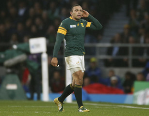 Bryan Habana of South Africa leaves the field after receiving a yellow card during their Rugby World Cup semi-final match against New Zealand at Twickenham in London