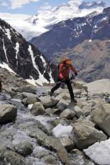 Woman hops boulder below the lookout point at Cerro Electrico, El Chalten, Argentina