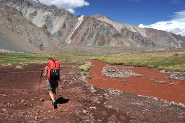 Woman descends the Horcones Valley from Plaza de Mulas on Aconcagua in the Andes Mountains, Mendoza Province, Argentina