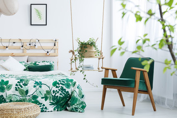 Bedroom with kale green armchair Wall mural