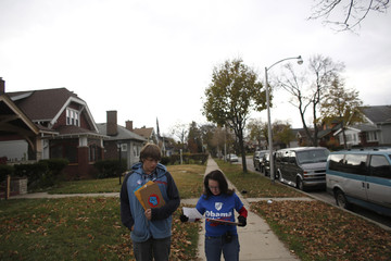 Stephanie Bloomingdale from the AFL-CIO and Connor Mathias go door to door canvassing in support of U.S. President Barack Obama in Milwaukee