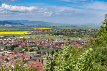 Spring view over Rasnov city, in Brasov county (Romania), with Cristian village in the right and Codlea city in the far left