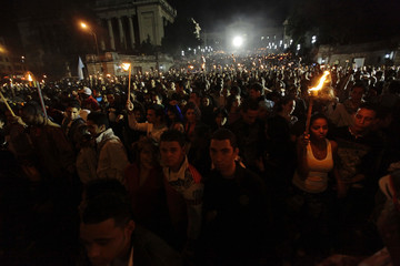 Thousands of members from the UJC and student organizations participate in a torch march in celebration of the 158th birth anniversary of Cuba's independence hero Jose Marti, in Havana