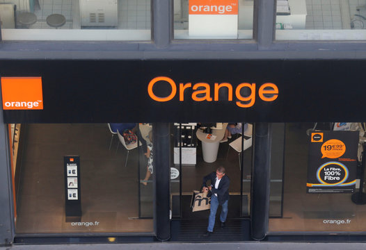 A man leaves a shop of French telecom operator Orange in Paris, France