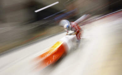 """Switzerland's Meyer and Graf speed down at the start of the two-woman bobsleigh competition test event at the """"Sanki"""" siding center in Rosa Khutor, a venue for the Sochi 2014 Winter Olympics near Sochi"""