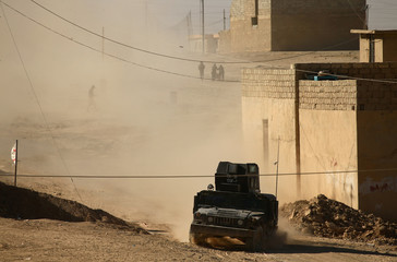 A military vehicle of Iraqi special forces drives during a battle with Islamic State militants in Mosul
